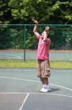 Man after making a basketball shot 2 Royalty Free Stock Photography
