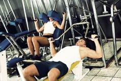 Man making bench press exercise using gym machinery Royalty Free Stock Photos