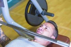 Man making bench press- workout routine Royalty Free Stock Photo