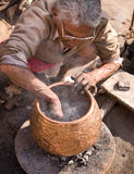 Man making bowl Stock Photo