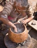 Man Making Bowl Stock Photo