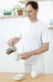 Man making breakfast Stock Images