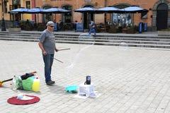 Man Making Bubbles to earn money Stock Photos