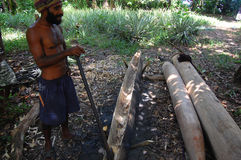 Man making canoe Papua New Guinea Stock Photography
