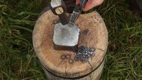Man making chain armor, blacksmith. Man making chain armor, hammer and anvil stock video