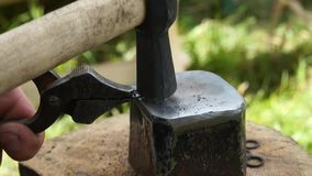Man making chain armor, blacksmith. Man making chain armor, hammer and anvil stock footage