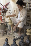 The man making clay pot. Chiang Mai, Thailand - April 13, 2016:  The man making clay pot at the ancient lanna house 140 years in water festival in Chiang Mai Royalty Free Stock Photos