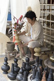 The man making clay pot. Chiang Mai, Thailand - April 13, 2016:  The man making clay pot at the ancient lanna house 140 years in water festival in Chiang Mai Stock Photo