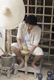 The man making clay pot. Chiang Mai, Thailand - April 13, 2016:  The man making clay pot at the ancient lanna house 140 years in water festival in Chiang Mai Stock Images