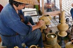 The man is making clay pot. Chiang Mai, Thailand - September 8, 2015: the man is making clay pot at Lanna expo held at Chiang Mai International Exhibition and Royalty Free Stock Image