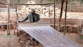 Man making cloth in Ethiopia stock video footage