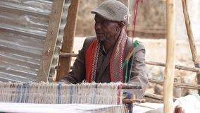 Man making cloth in Ethiopia stock footage