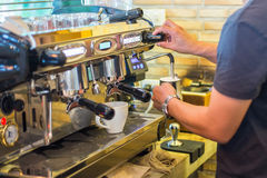 A Man Making coffee in the coffee machine. Fresh espresso Stock Photos