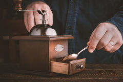 Man making coffee with coffee mill horizontal Royalty Free Stock Photo