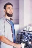 Man making a coffee Royalty Free Stock Image