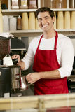 Man Making Coffee In Shop Stock Photography