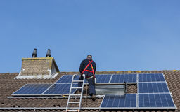 Man making construction with solar panels Stock Photography