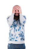 Man making a crazy desperation face. By grabbing his head Stock Photography