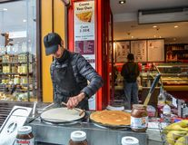 A man making crepe on street in Paris stock photography