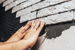 Man is making decorative brick wall Royalty Free Stock Photos
