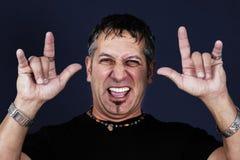 Man making devil gesture. Metal or biker guy making the devil gestures with his hands Royalty Free Stock Image