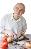 Man making dinner Stock Image