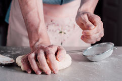 Man making dough for pizza Royalty Free Stock Photo