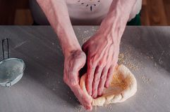 Man making dough for pizza Royalty Free Stock Photography