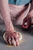 Man making dough for pizza Royalty Free Stock Images