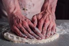 Man making dough for pizza Royalty Free Stock Photos