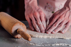 Man making dough for pizza Stock Photography