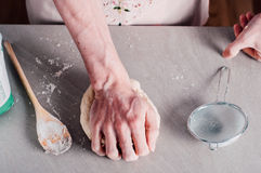 Man making dough for pizza Royalty Free Stock Image