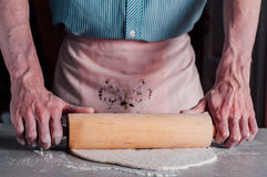 Man making dough for pizza Stock Photo