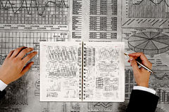 Man making financial notes. Businessman hands writing with pen infographs on paper Royalty Free Stock Image