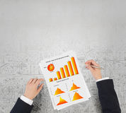 Man making financial notes. Businessman hands writing with pen infographs on paper Stock Photos