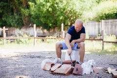 Man making fire for bbq Stock Photography