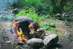Man making fire in countryside