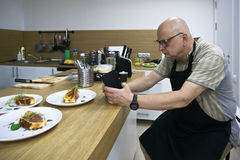 Man making food shots Stock Images