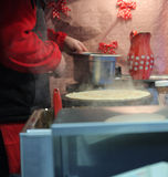 Man making french crepe at Christmas market Royalty Free Stock Photography