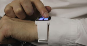 Man making gestures on a wearable smartwatch computer device stock footage