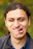 Man making grimace face, Troll face. Royalty Free Stock Photography