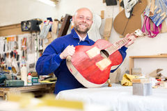 Man making a guitar Royalty Free Stock Photos