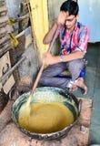 Man making halwa. Man preparing halwa fudge semolina Stock Photo