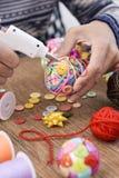 Man making a handmade christmas ball Royalty Free Stock Photos