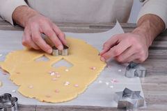 Man making heart shaped cookies close . Love, romantic St. Valentine's day surprise Stock Photos