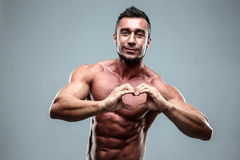 Man making heart symbol with his hands Stock Photos