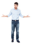 Man making helpless gesture. Young man over white background Stock Photos