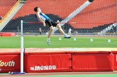 Man making high jump Stock Image