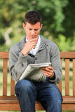 Man making his crossword Stock Images