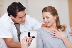Man making his girlfriend speechless with proposal stock photo